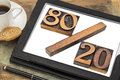 Pareto principle or eighty twenty rule represented in wood letterpress printing blocks on a digital tablet screen Stock Images