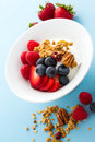 Parfait with fresh fruits and granola in white bowl Stock Photo