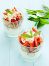 Parfait glasses with strawberry on the blue background shallow dof Royalty Free Stock Photo