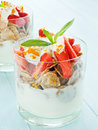 Parfait glasses with strawberry on the blue background shallow dof Royalty Free Stock Photography