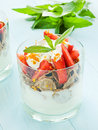 Parfait glasses with strawberry on the blue background shallow dof Royalty Free Stock Images