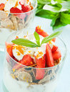 Parfait glasses with strawberry on the blue background shallow dof Stock Image