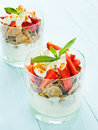 Parfait glasses with strawberry on the blue background shallow dof Stock Photo
