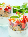 Parfait glasses with strawberry on the blue background shallow dof Stock Photography