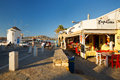 Parikia on paros island restaurant and a historic mill the seafront of the capital and main port of in greece Royalty Free Stock Photo