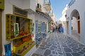 Parikia on paros island street with shops and traditional architecture in the old part of the capital and main port of in greece Stock Photos