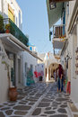 Parikia on paros island street with shops and traditional architecture in the old part of the capital and main port of in greece Royalty Free Stock Images