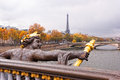 Paris in autumn with eiffel tower cherub on pont alexandre iii Stock Photos