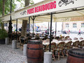Paris beaubourg cafe awning and tables in front of beaubourg fountain sign on stretches over empty with background Royalty Free Stock Image