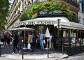 Paris cafe france july diners enjoy the sun at the famous de flore in the lifestyle draws millions of tourists to Stock Photography