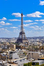 PARIS, FRANCE, EUROPE -Eiffel Tower & blue sky with clouds, Paris, France - JULY 24, 2015 Royalty Free Stock Photo