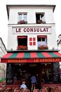 stock image of  Paris, France, The famous Le Consulat restaurant with tourists. Rainy day.