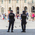 Paris france july french police control the street a at louvre during one of busiest days of year of Royalty Free Stock Photos