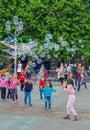 stock image of  Paris, France, June 2019: Children enjoying bubbles show on the Place de l`Hotel de Ville