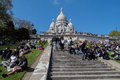 PARIS, FRANCE - MAY 1 2016 - Montmartre stairway crowded of people for sunday sunny day Royalty Free Stock Photo