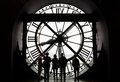 Paris, France - May 14, 2015: Silhouettes of unidentified tourists looking through the clock in the museum D'Orsay. Royalty Free Stock Photo