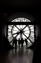 Paris, France - May 14, 2015: Silhouettes of unidentified tourists in the museum D'Orsay. Royalty Free Stock Photo