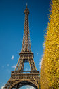 PARIS, FRANCE - NOVEMBER 9, 2014 Eiffel Tower over blue sky and Royalty Free Stock Photo