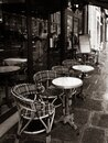 Paris, France, Parisian cafe, tables and chairs on paved sidewalk, black and white photo Royalty Free Stock Photo