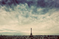Paris, France skyline with Eiffel Tower. Dark clouds