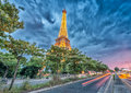 PARIS - JUNE 11, 2014: Lights of Eiffel Tower at night. La Tour Royalty Free Stock Photo