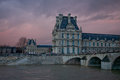 Paris louvre in winter time on sunshine winter in lovre on the winter sunshine Royalty Free Stock Photo