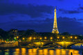 Paris may cityscape of paris with eiffel tower tour eiffel and pont des invalides at night illumination on the is Royalty Free Stock Photo