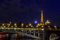 Eiffel Tower and Pont Alexandre III at night Royalty Free Stock Photo