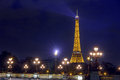 Paris may eiffel tower and pont alexandre iii at night ill tour illumination on the is the most famous Stock Image