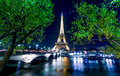 Paris night cityscape.  Eiffel tower light show on Seine river Royalty Free Stock Photo