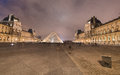 Paris nov louvre museum lights at night november in is the biggest in with over square meters of Stock Photos