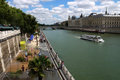 Paris plages beaches france view of plage and the seine river where a bateau mouche is to be seen are temporarily transformed Royalty Free Stock Photography