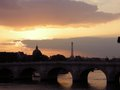 Paris sunset bridge over the river seine with the eiffel tower in the background at Stock Photos