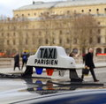 Paris taxi bridge over river seine people background Royalty Free Stock Photo