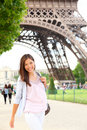Paris woman by Eiffel Tower Royalty Free Stock Image