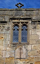 Parish church stone facade and leaded windows old sundial warkworth northumberland Royalty Free Stock Images