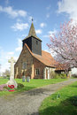 Parish church and war memorial in rural springtime setting essex england united kingdom Stock Photos