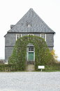 The parish house residence and office of pastor located in middle of village in view of churchyard freilichtmuseum Royalty Free Stock Image