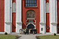 Parishioners wait for the beginning of a morning prayer vilnius lithuania april elegantly dressed in saint jacob church Stock Photo