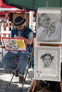 Parisian artist drawing a caricature in montmartre of paris france june place du tertre which is famous hangout for buskers and Stock Photos