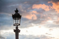 Parisian lamppost against clouds at sunset Royalty Free Stock Photo