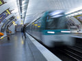 Parisian metro train approaching a station in paris france Stock Images
