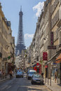 Parisian street paris france st july afternoon aspect of a narrow leading to the famous eiffel tower the eiffel tower is the most Royalty Free Stock Images