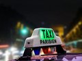 Parisian taxi cab closeup of against the blurred champs elysees at night paris france Royalty Free Stock Photography