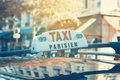 Parisian taxi with car reflection retro filter effect Royalty Free Stock Photos