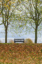 Park bench autumn UK Royalty Free Stock Photography