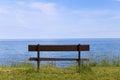 Park bench empty facing the ocean Royalty Free Stock Photos