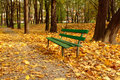 Park bench in fall park Royalty Free Stock Photos