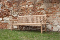 Park bench garden front brick wall Royalty Free Stock Image