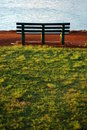 A Park Bench Beside the Ocean Royalty Free Stock Image